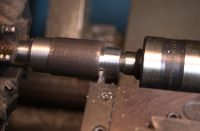 "Grooving operation on the 4140 brazed carbide body using a Newcomer grooving tool.  The 1/16"" silver rod from Prince/izant AWS A5.8 BAg-22 rod is turned into preform rings and placed into the groove.  The carbide ring fits over the turned surface with the silver ring in place facilitating the brazing process."