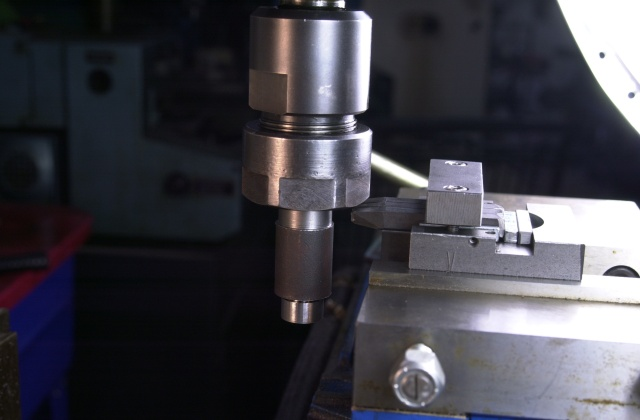 Branding and marking the size of the brazed carbide mitre cutters using the old fashioned roll stamping technique.
