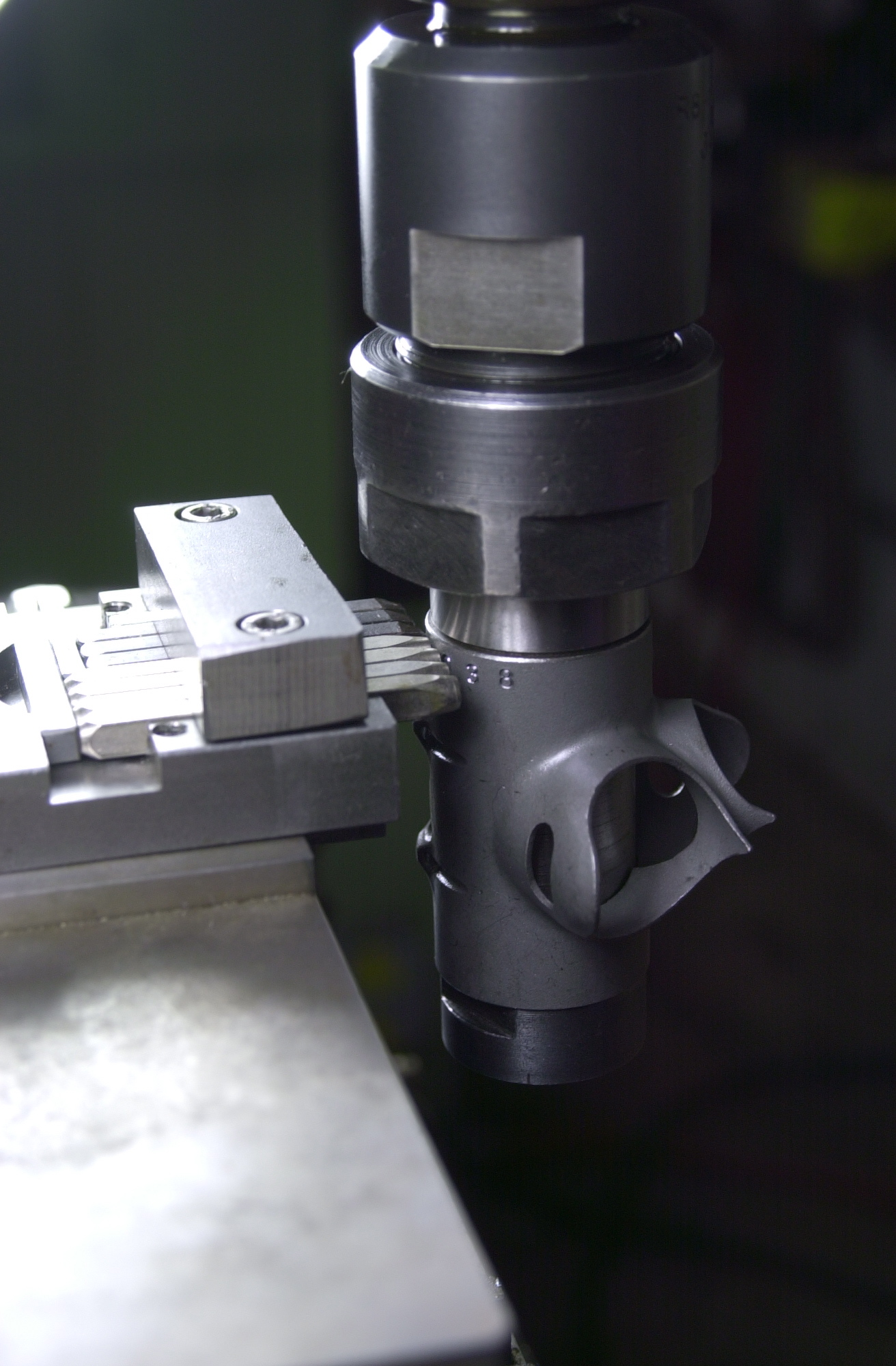 Roll stamping serial numbers into bottom bracket shells of a couple new frames coming up.  Stamps are held in a small fixture clamped in a Kurt machine vise while the bottom bracket shell is secured in an arbor held in a collet.  The collet is free to rotate in the Bridgeport mill while the stamps roll by under pressure.