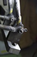 Closeup of the brass brazed seatstay/dropout joint.