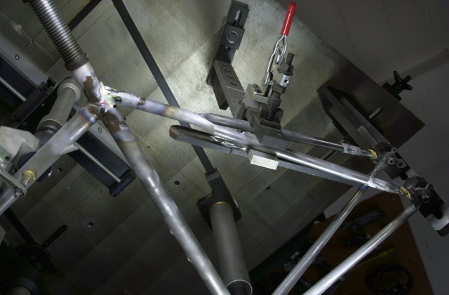 Photo of Donald's frame after completing rear triangle brazing.  Marchetti fixture clamps the rear triangle ensuring proper alignment.  Fixture is rotated so that the seatstays are vertical for brazing to the dropouts and then rotated so that the seat tube is horizontal to aid silver brazing flow at the seat lug/top stay binder joint.