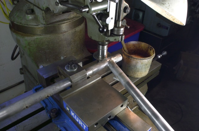 The seat lug must be slit before the wishbone topstay binder is brazed to the frame and this is the simple set up on the Bridgeport mill.  The frame is held in an old Var tube clamp which is clamped in a Kurt milling machine vise.  A 0.128 inch slitting saw is used to perform the operation.