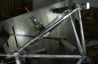 Another photo of the wishbone rear triangle showing the alignment clamp and the dropout clamps.  Once the topstay binder is silver brazed to the rear of the seat lug the seatstay tips are brass brazed into the Llewellyn cast dropouts.