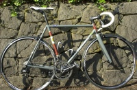 Strawberry 2012 Custom Road Frameset. Here is an offering for cyclists looking to purchase a fine handbuilt frameset (custom frame + fork + headset) who have frame geometry settled in their mind. The frames are hand brass brazed in Reynolds 631 Air Hardening steel tubing. Why brass brazing? Reynolds 631 pre-brazed strength is in the range of 800-900 MPa and the after brazed strength is significantly higher. Quoting Reynolds &quot; The strength to weight ratio of the air hardening steels is equal to that of quality titanium and aluminum frames. A normal chrome molybdenum steel will lose strength in the joints after the heat has been applied. This material (631) INCREASES in strength when heated to around 850 degrees C (1560 degrees F), (note: 850 degrees is the BRASS BRAZING temperature - silver brazing does not achieve this increase in strength) and the recommended braze metal is used per AWS Classification, RBCuZn type. As the frame cools the tubing increases in strength to well in excess of the as delivered values shown above. This unique air hardening property of Reynolds 631 provides additional stiffness through reduced micro-yielding at the joints, allowing stiffer frames with excellent fatigue strength when compared to standard chrome molybdenum and excellent ride quality to be constructed.&quot; An Enve road carbon fork is matched to the frame and is sold assembled with a 1-1/8&quot; headset. The frames are fabricated with Marchetti fixtures in the Strawberry Workshop (shop pics may be viewed by clicking on the Mechanique link), Portland, Oregon by Andy Newlands who has over forty (check out the new belt buckle!) years experience in the cycles engineering and fabrication field. Materials include the finest investment cast bottom bracket (English threading), lugs, dropouts, Strawberry designed wishbone rear triangle with the new LAN71 Integrated Seatpost Binder, and full compliment of braze-on's. Paint scheme includes customer's choice of body color (red, green, blue, purple, apricot, or your favorite. Let me know if you wish to receive an Imron color chart to facilitate the choice). Cost is $1850.00 for one color powder paint or $2150 for wet paint (pretty near whatever color scheme you can dream up and my friend Keith Anderson can execute) Ex Works, Goose Hollow, Portland, Oregon. Shipment via UPS throughout lower 48 states is $100.00. To receive a four color brochure and order form (pdf order form is now online) in the mail, please go to the contact link. Note: these frames are close clearance - not fender friendly.