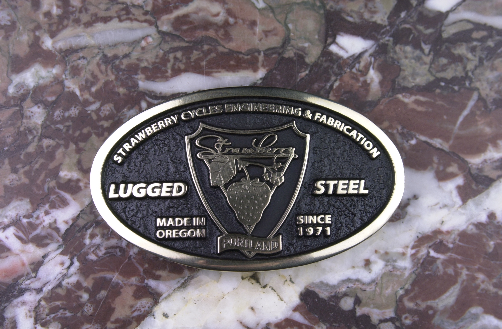 "Strawberry 45 year commemorative brass belt buckle designed by my wife, Kelley Dodd (www.krdpdx.com) and manufactured in the USA.  $35.00 delivered via USPS throughout the lower 48.  To order, please contact Andy. PayPal and good check accepted.  Buckle is designed for Western belts up to 1-3/4"" wide and is cast in solid brass and measures approximately 3-3/4"" x 2-1/4""."