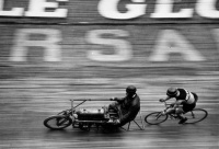 Racing behind the derny.  Board track racing circa 1930's.