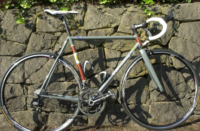 October, 2011.  My new road bike.  Reynolds 631 Air Hardening steel lugged frame with an Enve carbon fork , handlebar, stem and seatpost.  Gorgeous paint by Keith Anderson.   Campag Record group.  At least I'll have a good looking bike - the cyclist may be out of shape and slow.