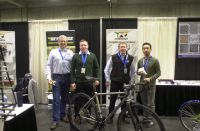 Reynolds Technology Ltd. crew (Andy Newlands, Torch and File distributor for Reynolds in USA missing (photographer)) at the 2016 NAHBS.  L to R: Ed Blessman, Metallurgical Engineer with Plymouth Tube Co; Tom Cleverly, Materials Engineer (Special Projects) with Reynolds; Paul Murphy, Production  Manager with Reynolds; Anthony Lim of Fairing.  Foreground: TI Cycles titanium bike fabricated from Reynolds butted titanium tubes and sporting the new Reynolds 3D printed disc-ready rear dropouts.