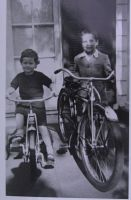 1954 my sister Ann age four perhaps on her tricycle  and me at age eight with my first bike.  Photo courtesy of the man with the hat (note the shadow by Ann's front wheel)  probably our father in front of our home on Riverwood Road, Portland, Oregon.