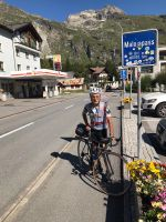Dr. Marco summiting Malojapass, Italy on his Strawberry road bike.