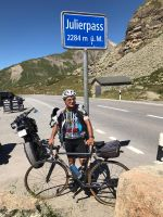 Dr. Marco summiting Julierpass, Italy on his Strawberry road bike.