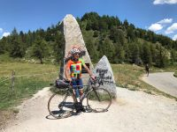 Dr. Marco summiting Passo Del Mortirolo, Italy on his Strawberry road bike.
