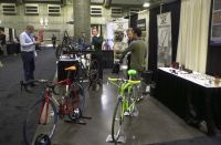 2016 Reynolds Technology Ltd. booth at NAHBS.  Strawberry red/white road bike in foreground.