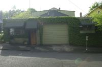 2013 May.  Strawberry Garage with three awnings.  Bird feeder has moved north.  All else is the same as 2010.