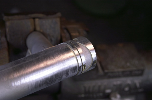 A head tube extension has been fabricated out of the bottom rim from a down tube lug and brazed to the top end of the head tube.  The head tube with both top and bottom lugs tacked is now ready to complete the main triangle for brazing.