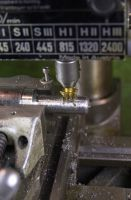 Cutting the Weldon set screw surface on the Emco Maximat V10P machine using a Niagara single angle chamfering cutter.