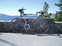2007 Cycle Oregon.  My new bike somewhere along Crater Lake Rim Drive.  650C wheels, 73 degree head angle, 40mm. fork offset, 51cm seat x 54 top tube, 26cm b.b. height (thereabouts), 39.6cm. chainstays. Worked good, felt stable, now if only I could find some form.