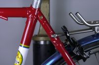 Seat lug and rear rack attachment to wishbone topstay.