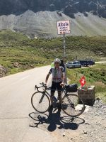 Dr. Marco summiting Albula Pass, Italy on his Strawberry road bike.