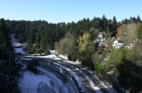 Snow day, December, 2008.  View to the west from the Vista Bridge.  MAX light rail entering the tunnel.